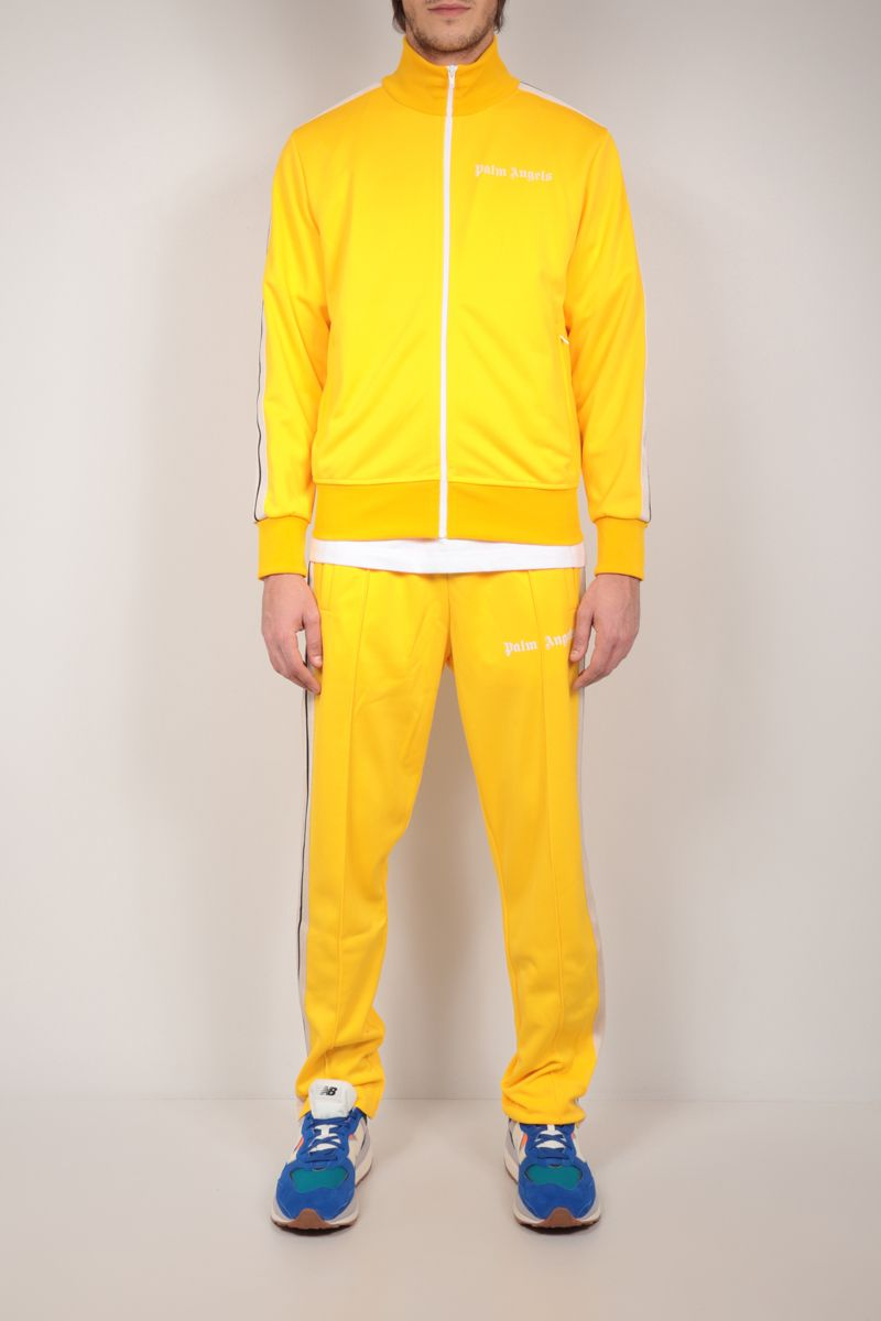 PALM ANGELS: logo print technical jersey track pants Color Yellow_2