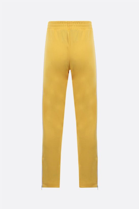 PALM ANGELS: logo print technical jersey joggers Color Yellow_2