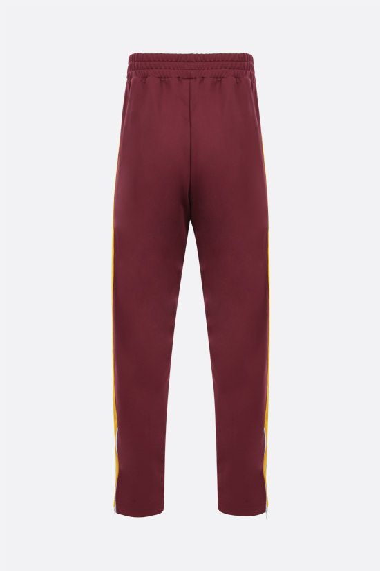 PALM ANGELS: pantalone jogging in jersey tecnico stampa logo Colore Rosso_2