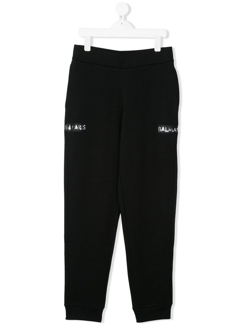 BALMAIN KIDS: pantalone jogging in cotone con patch logo Colore Nero_1