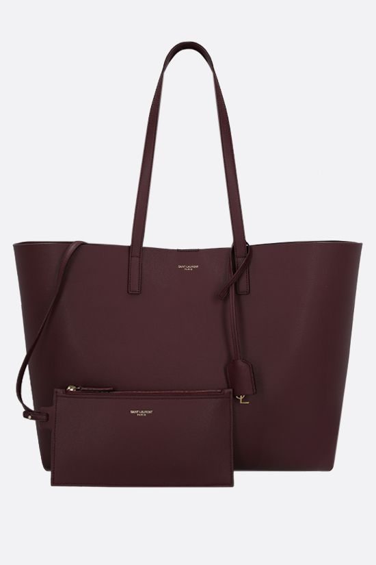 SAINT LAURENT: East West smooth leather tote bag Color Red_2