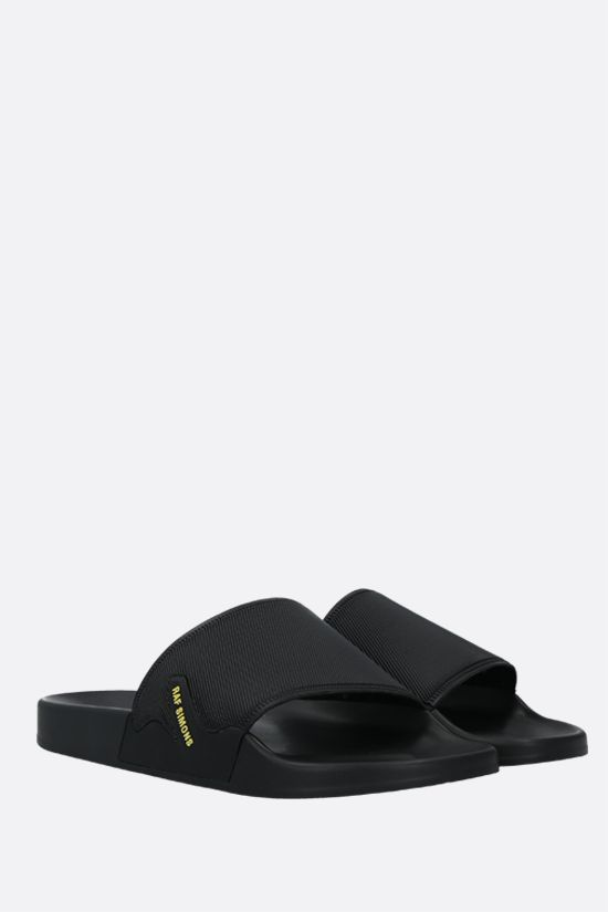 RAF SIMONS: Astra rubber slide sandals Color Black_2
