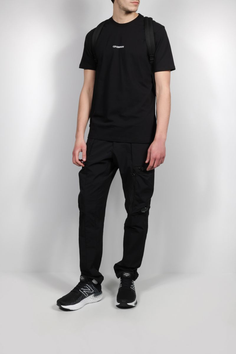 CP COMPANY: stretch nylon cargo pants Color Black_2