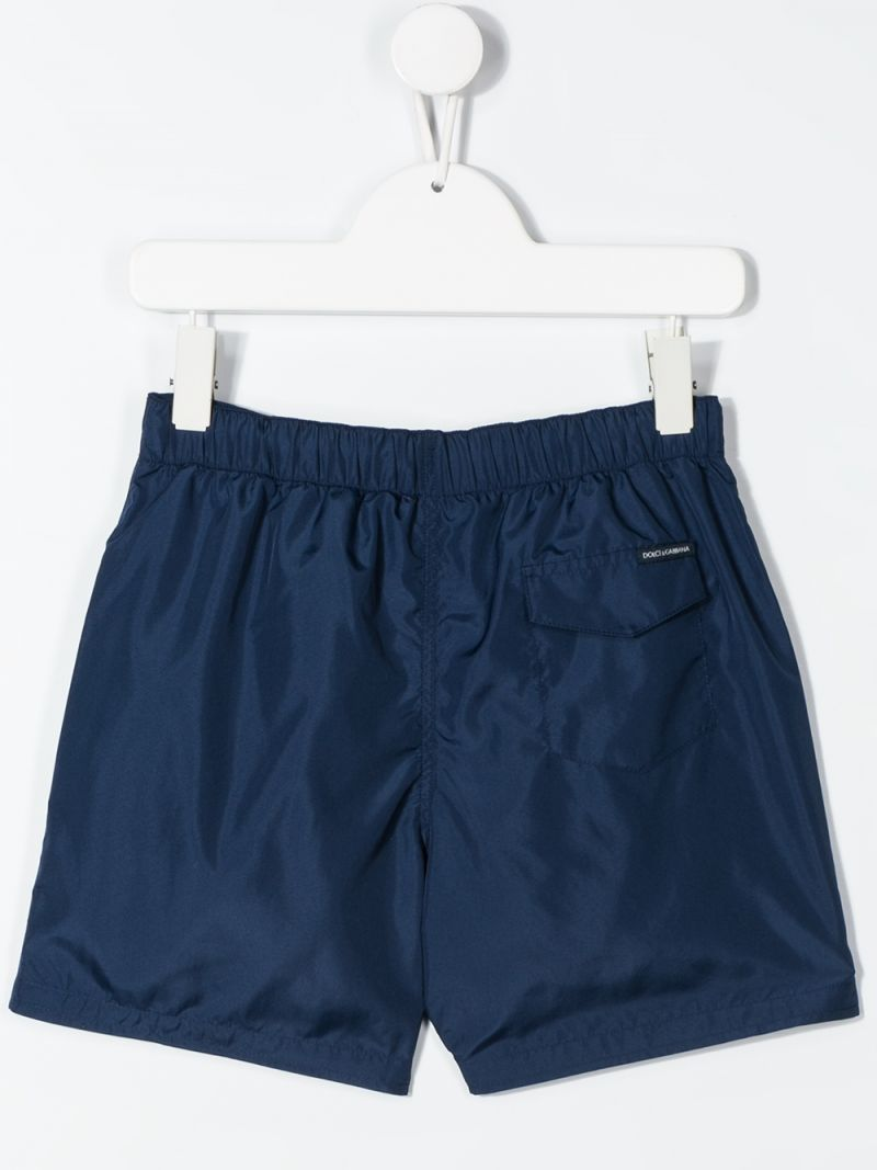 DOLCE & GABBANA CHILDREN: logo print nylon swimming trunks Color Blue_2