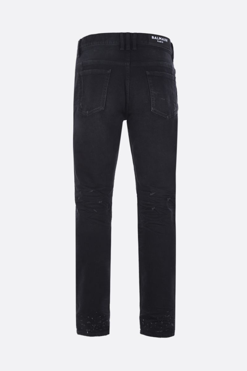 BALMAIN: tapered-fit jeans with distressed effect Color Black_2