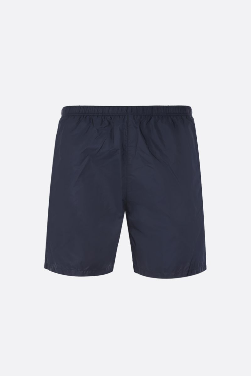 PRADA: logo patch-detailed nylon swimshorts Color Blue_1