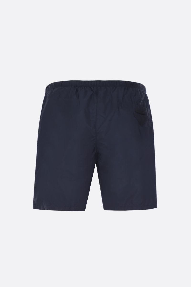 PRADA: logo patch-detailed nylon swimshorts Color Blue_2