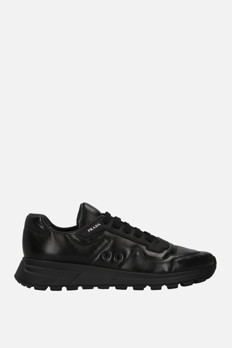 PRADA: sneaker low-top in morbida nappa Colore Nero_1