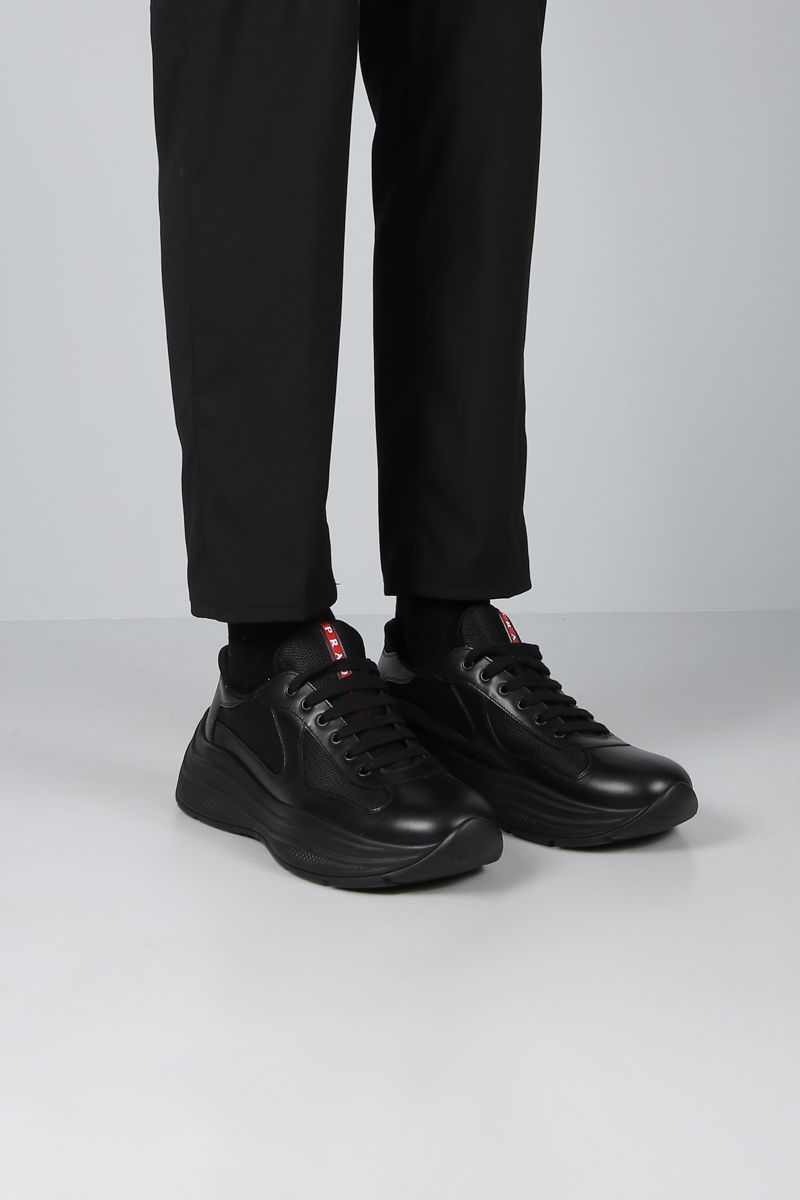 PRADA: smooth leather and mesh flatform sneakers Color Black_2