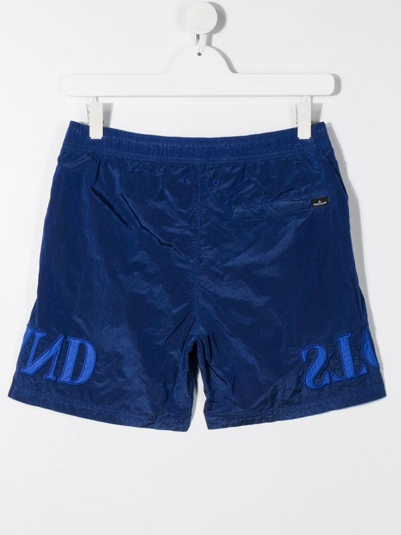 STONE ISLAND JUNIOR: logo embroidered nylon swim shorts Color Purple_2