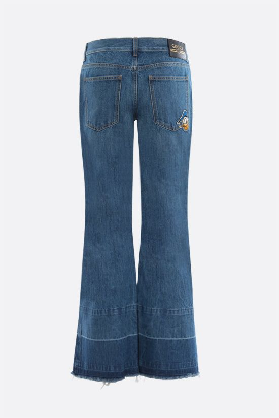 GUCCI: Donald Duck Disney x Gucci flare jeans Color Blue_2
