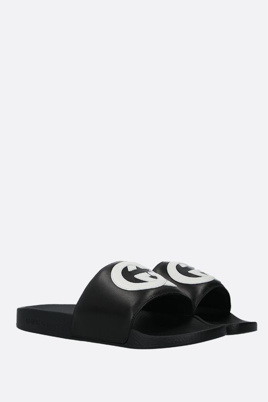 GUCCI: Interlocking G patch smooth leather slide sandals Color Black_2