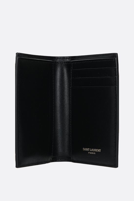 SAINT LAURENT: Monogram shiny leather vertical wallet Color Black_2