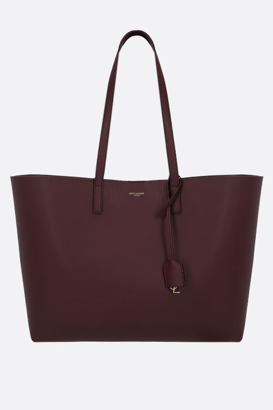 SAINT LAURENT: East West smooth leather tote bag Color Red_1