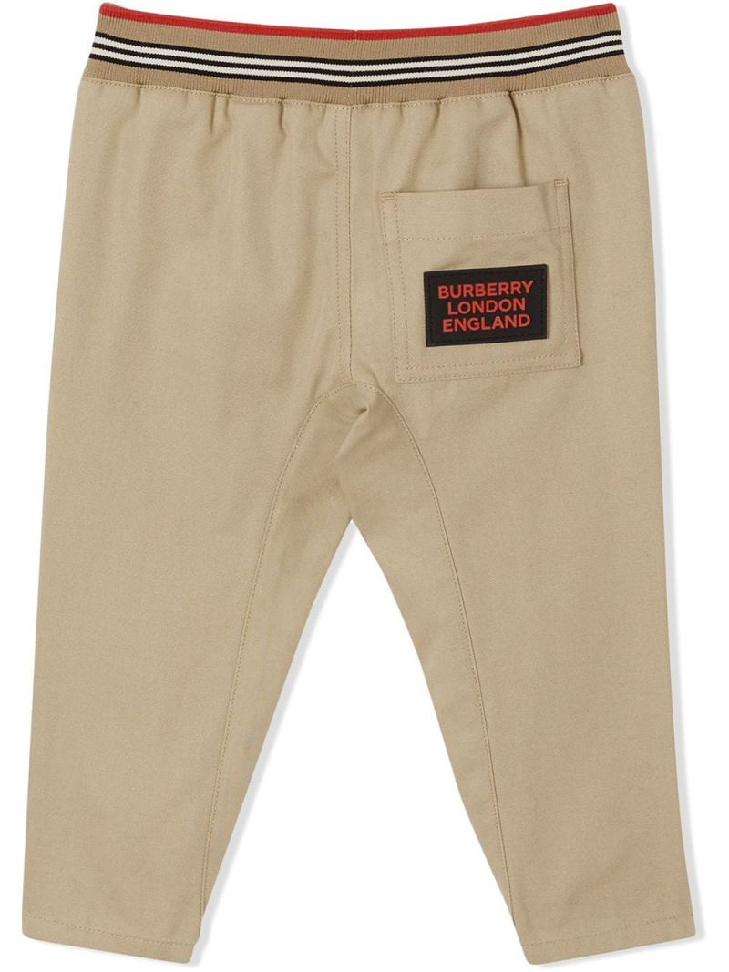 BURBERRY CHILDREN: Icon Stripe-detailed cotton pants Color Yellow_2