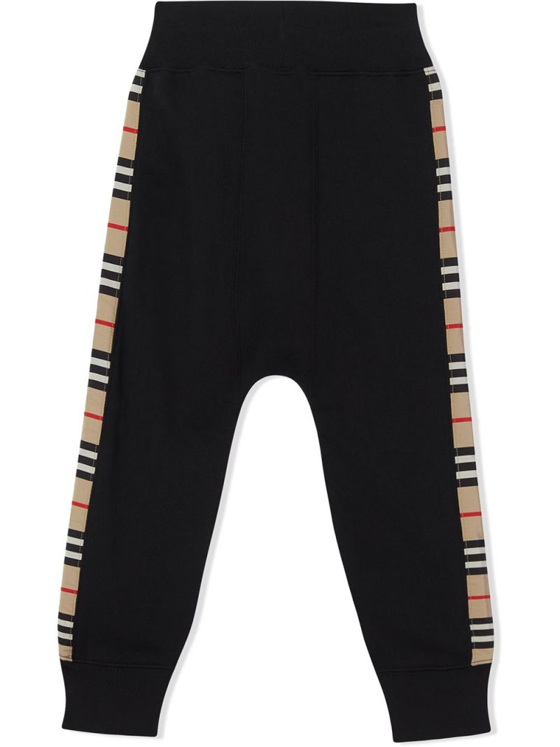 BURBERRY CHILDREN: Icon Stripe band-detailed cotton joggers Color Black_2