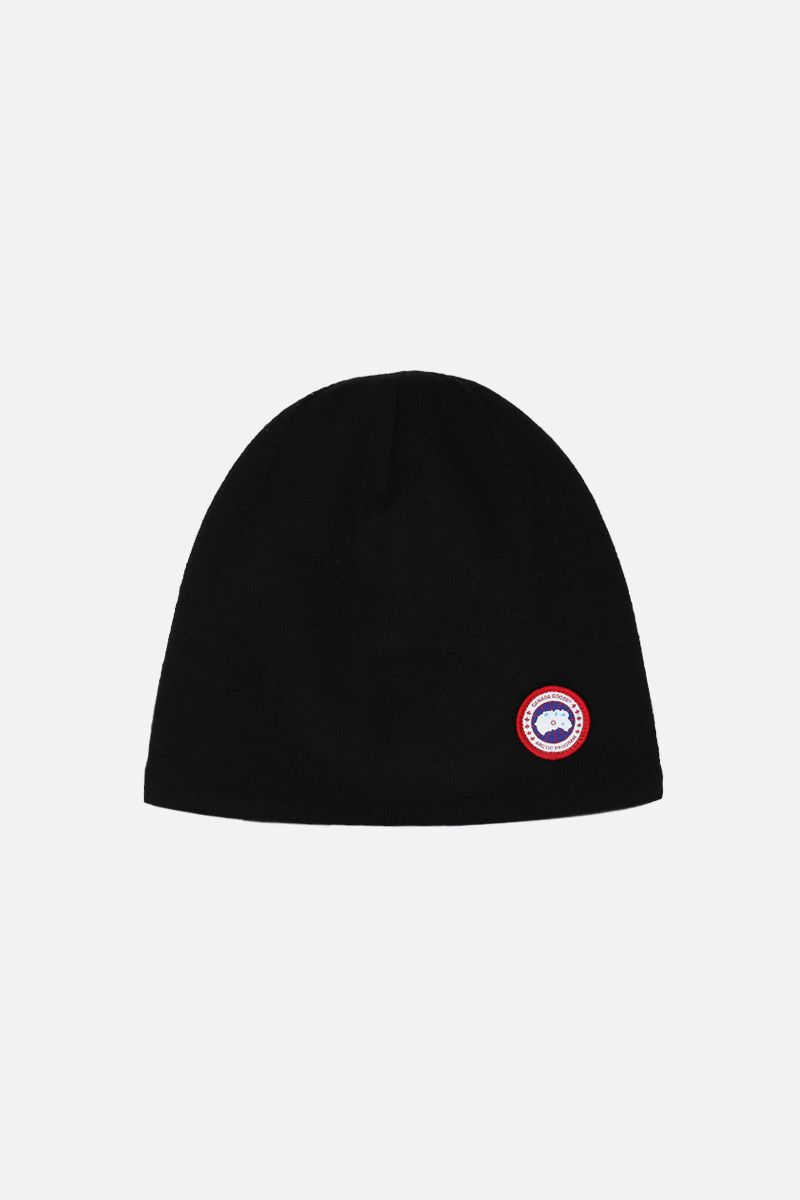 CANADA GOOSE: berretto in lana stretch con badge logo Colore Nero_1