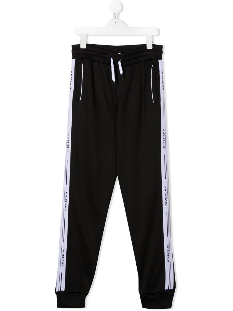 GIVENCHY KIDS: logoed band-detailed technical cotton joggers Color Black_1