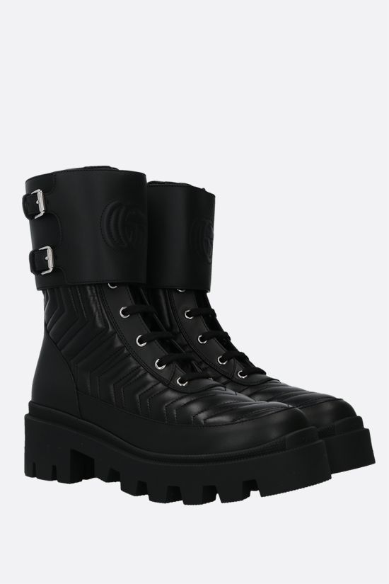 GUCCI: Double G-detailed quilted leather combat boots Color Black_2