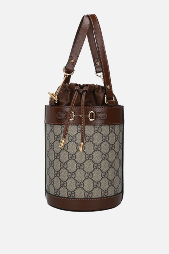 GUCCI: Horsebit 1955 small leather and GG Supreme canvas bucket bag_1