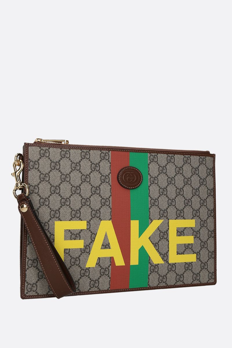 GUCCI: Fake/Not print GG Supreme clutch Color Neutral_2