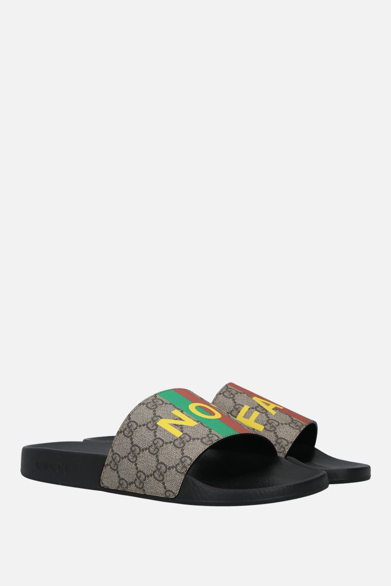 GUCCI: Fake/Not print GG Supreme slide sandals Color Neutral_2