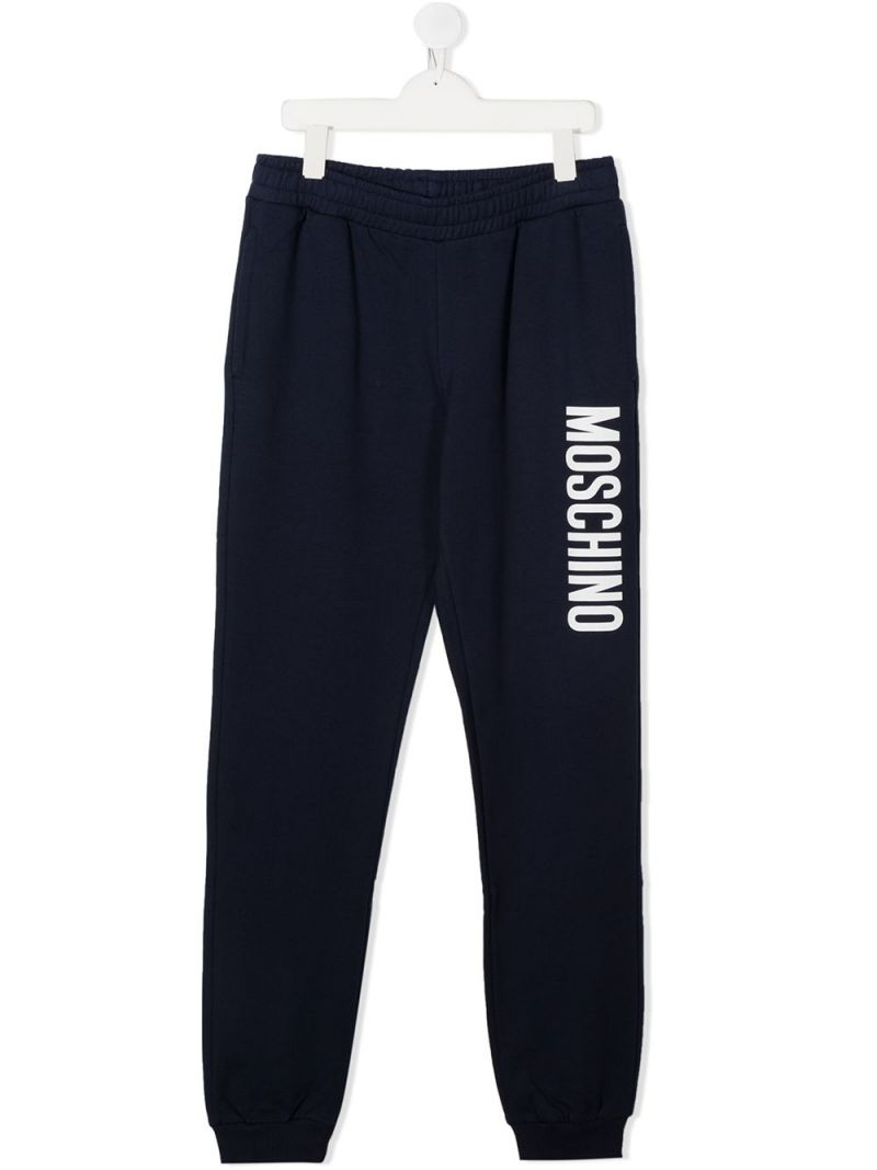 MOSCHINO KIDS: logo print stretch cotton joggers Color Blue_1
