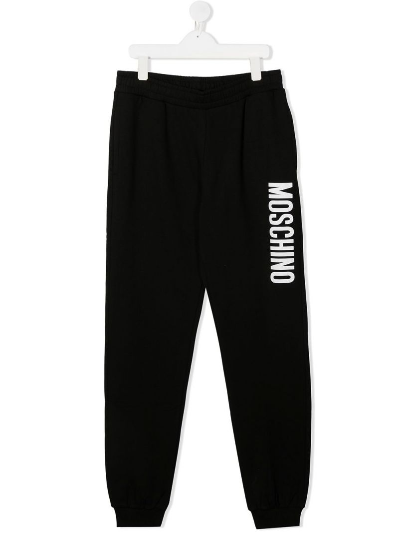 MOSCHINO KIDS: logo print stretch cotton joggers Color Black_1