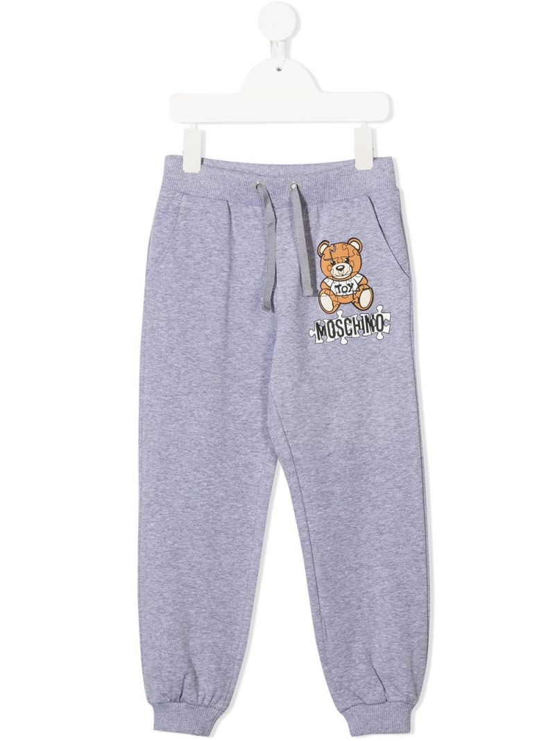 MOSCHINO KIDS: Puzzle Teddy Bear print stretch cotton joggers Color Grey_1