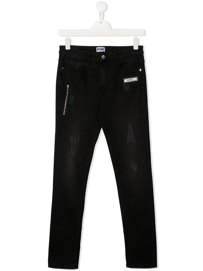 MOSCHINO KIDS: jeans skinny patch logo Colore Nero_1