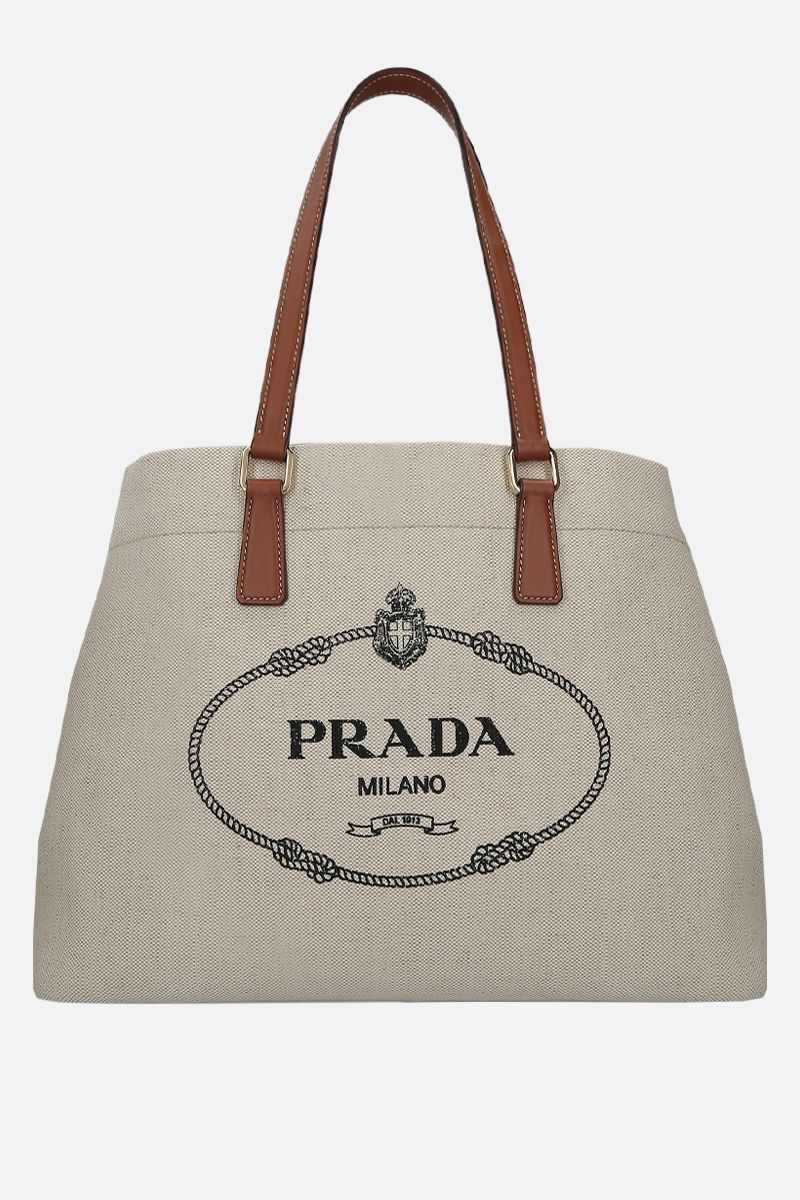 PRADA: borsa shopping in canvas e pelle liscia_1