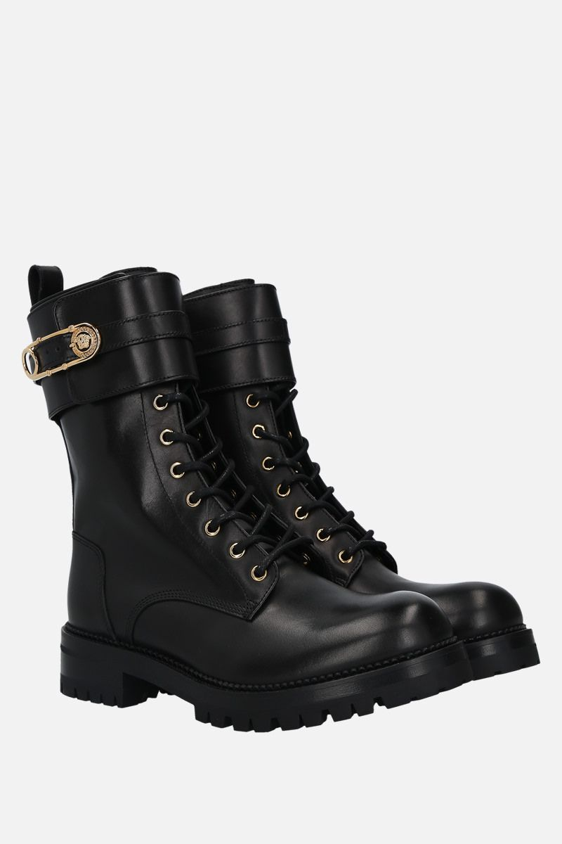 VERSACE: Safety Pin shiny leather combat boots Color Black_2