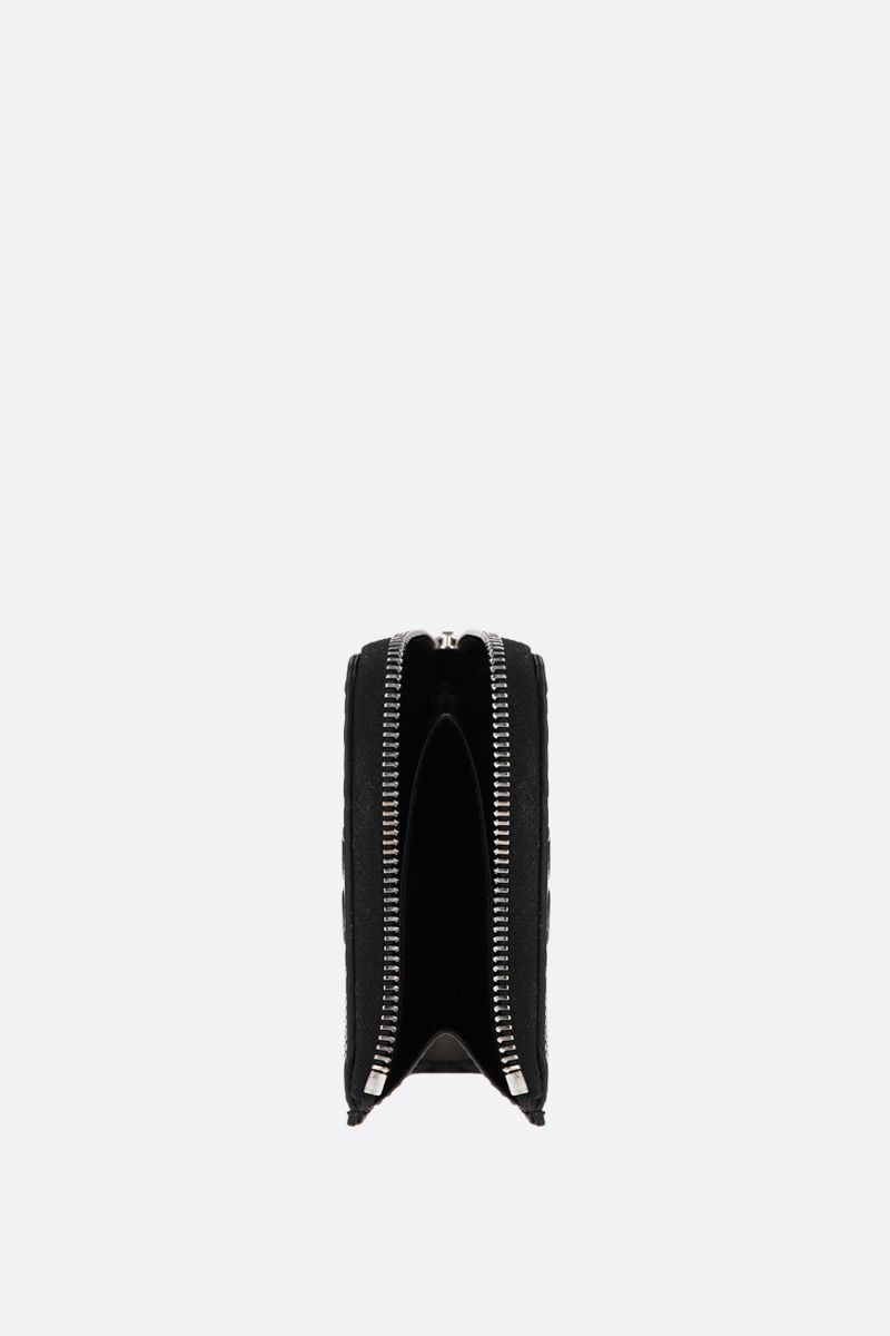 GUCCI: GG embossed leather half-zip wallet Color Black_2