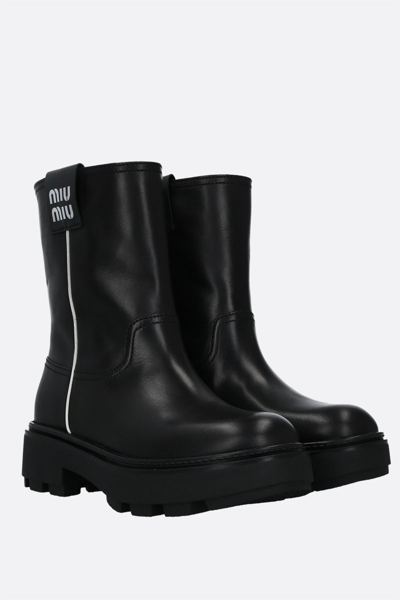 MIU MIU: logo-detailed smooth leather pull-on boots Color Black_2