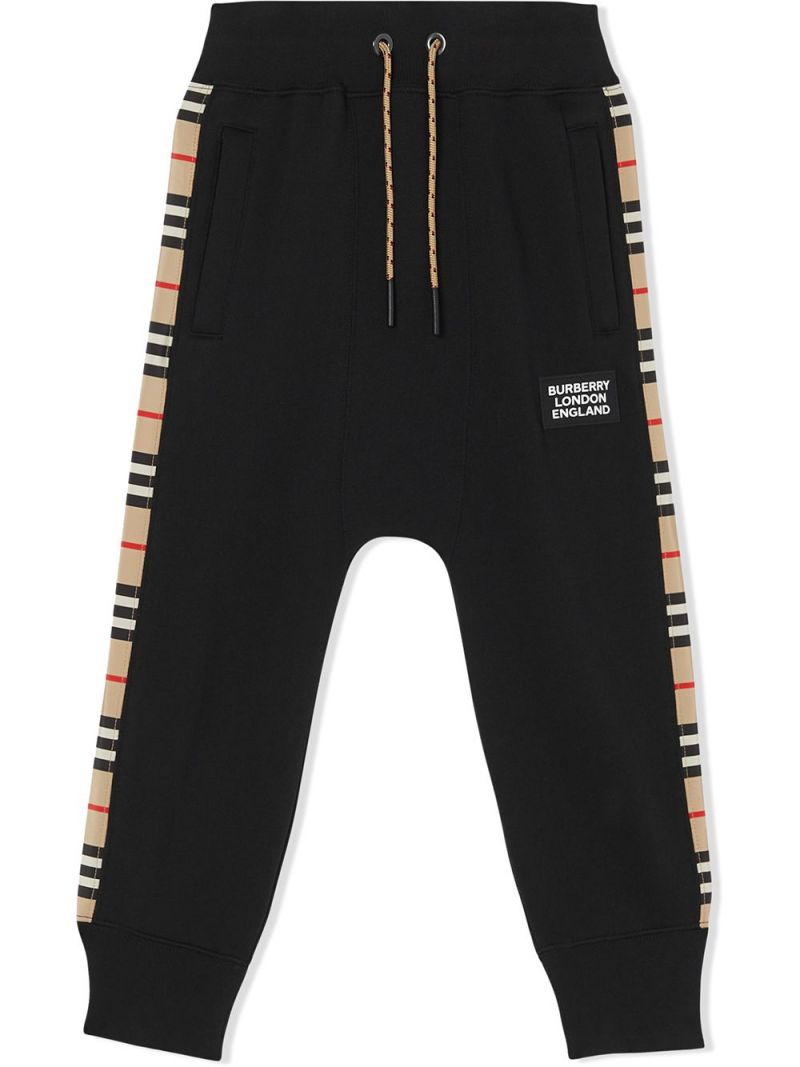BURBERRY CHILDREN: Icon Stripe band-detailed cotton joggers Color Black_1