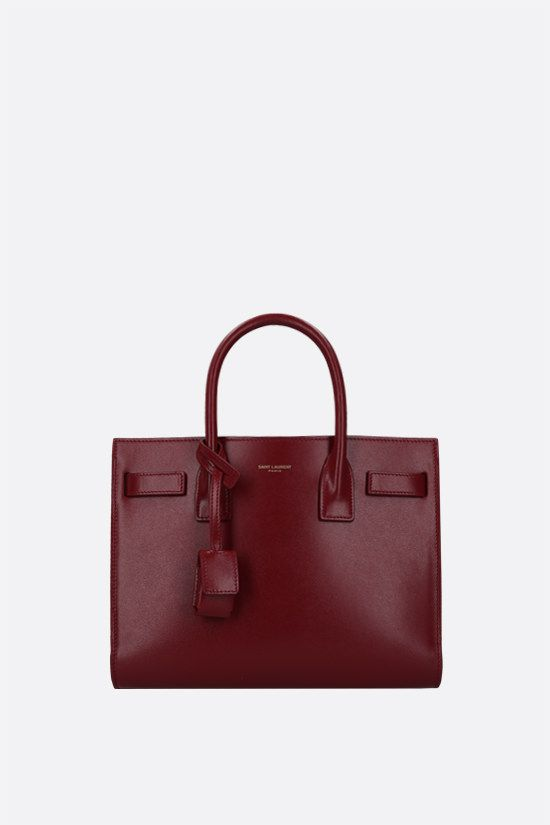 SAINT LAURENT: Sac de Jour baby shiny leather handbag Color Red_1