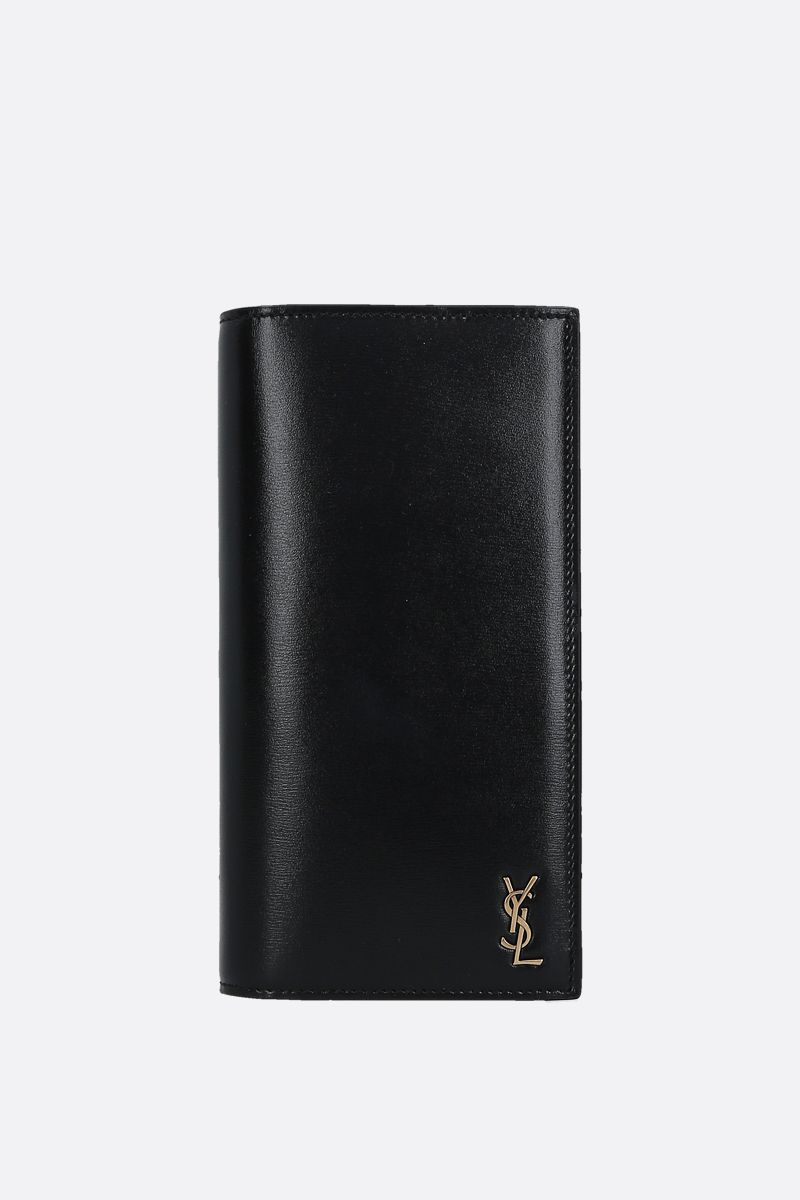 SAINT LAURENT: Monogram shiny leather vertical wallet Color Black_1