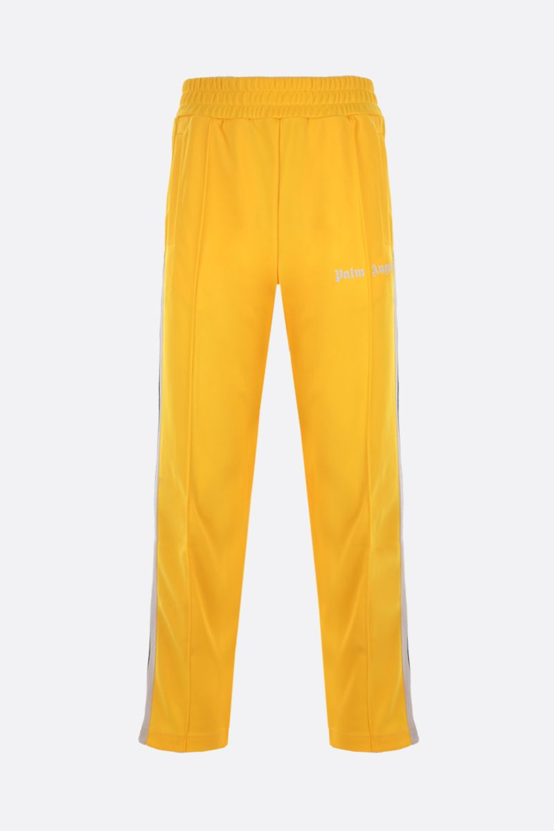 PALM ANGELS: logo print technical jersey track pants Color Yellow_1