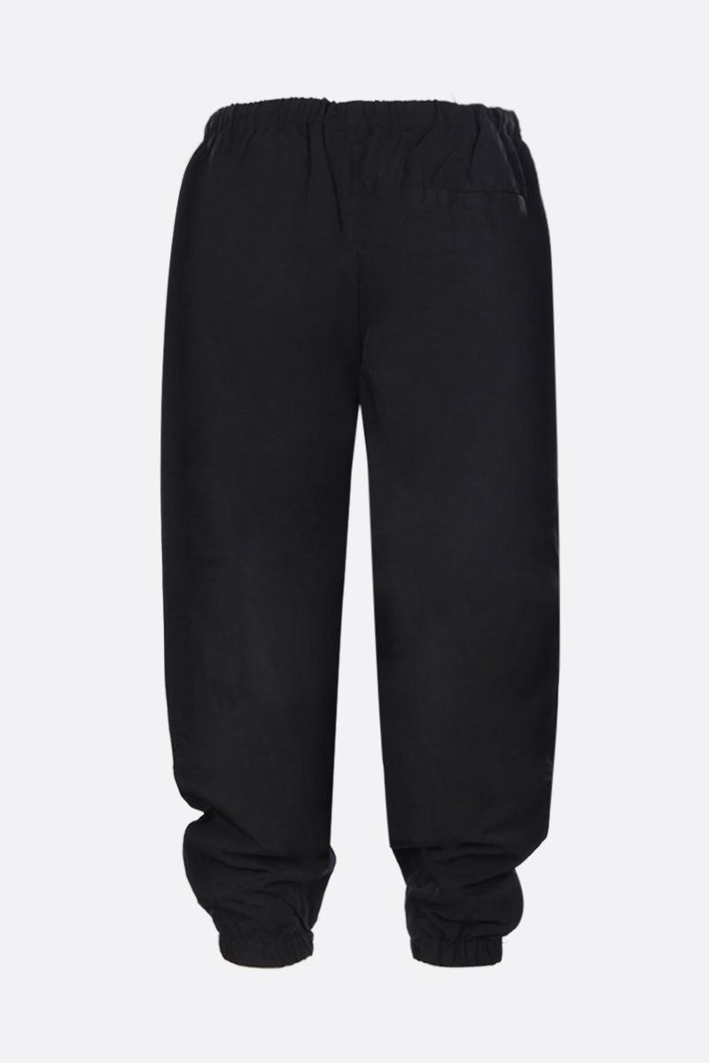 MARCELO BURLON COUNTY OF MILAN: pantalone jogging in nylon con logo ricamato Colore Nero_2