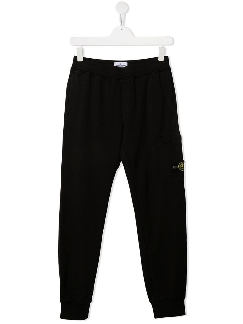 STONE ISLAND JUNIOR: logo badge-detailed cotton joggers Color Black_1