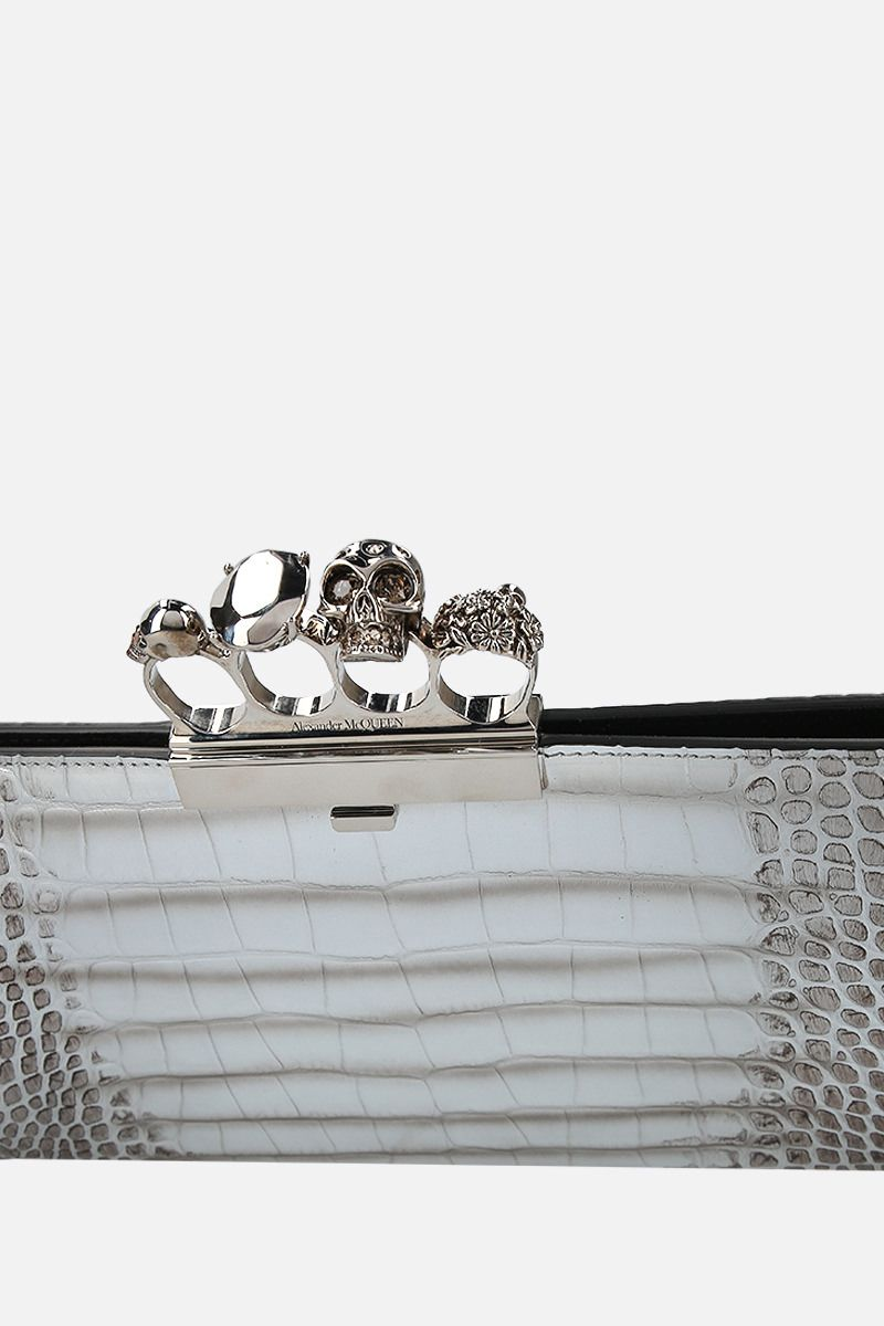 ALEXANDER McQUEEN: Skull four-ring clutch in crocodile embossed leather Color Silver_5