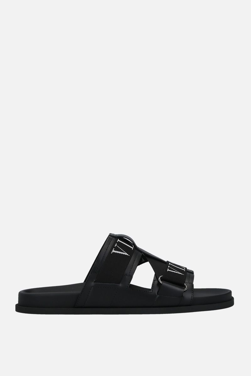 VALENTINO GARAVANI: VLTN smooth leather flat sandals Color Black_1
