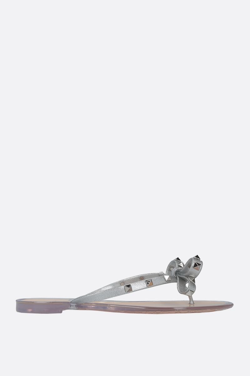 VALENTINO GARAVANI: Rockstud thong sandals in PVC Color Silver_1