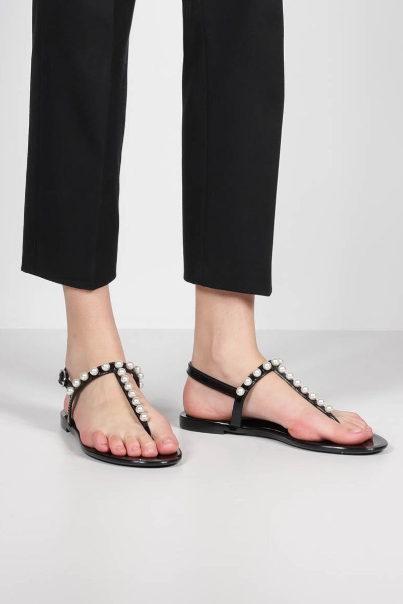 STUART WEITZMAN: Goldie Jelly shiny rubber thong sandals Color Black_2