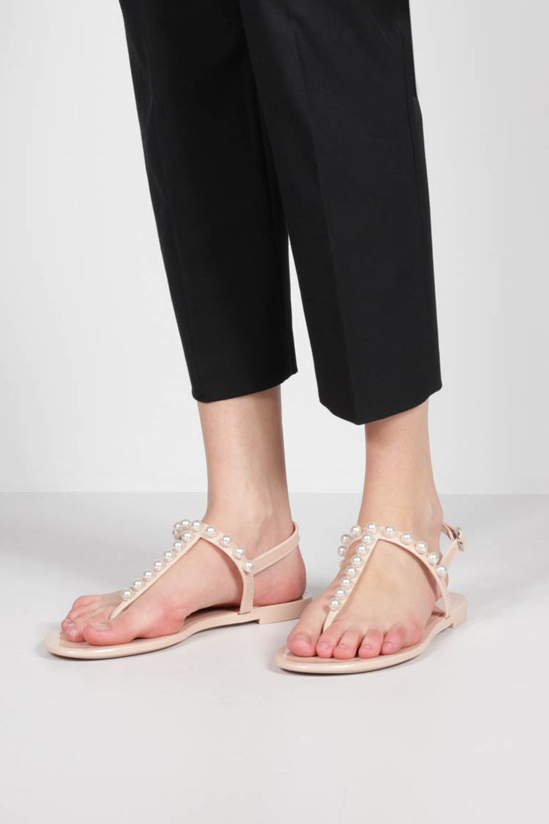 STUART WEITZMAN: Goldie Jelly shiny rubber thong sandals Color Neutral_2