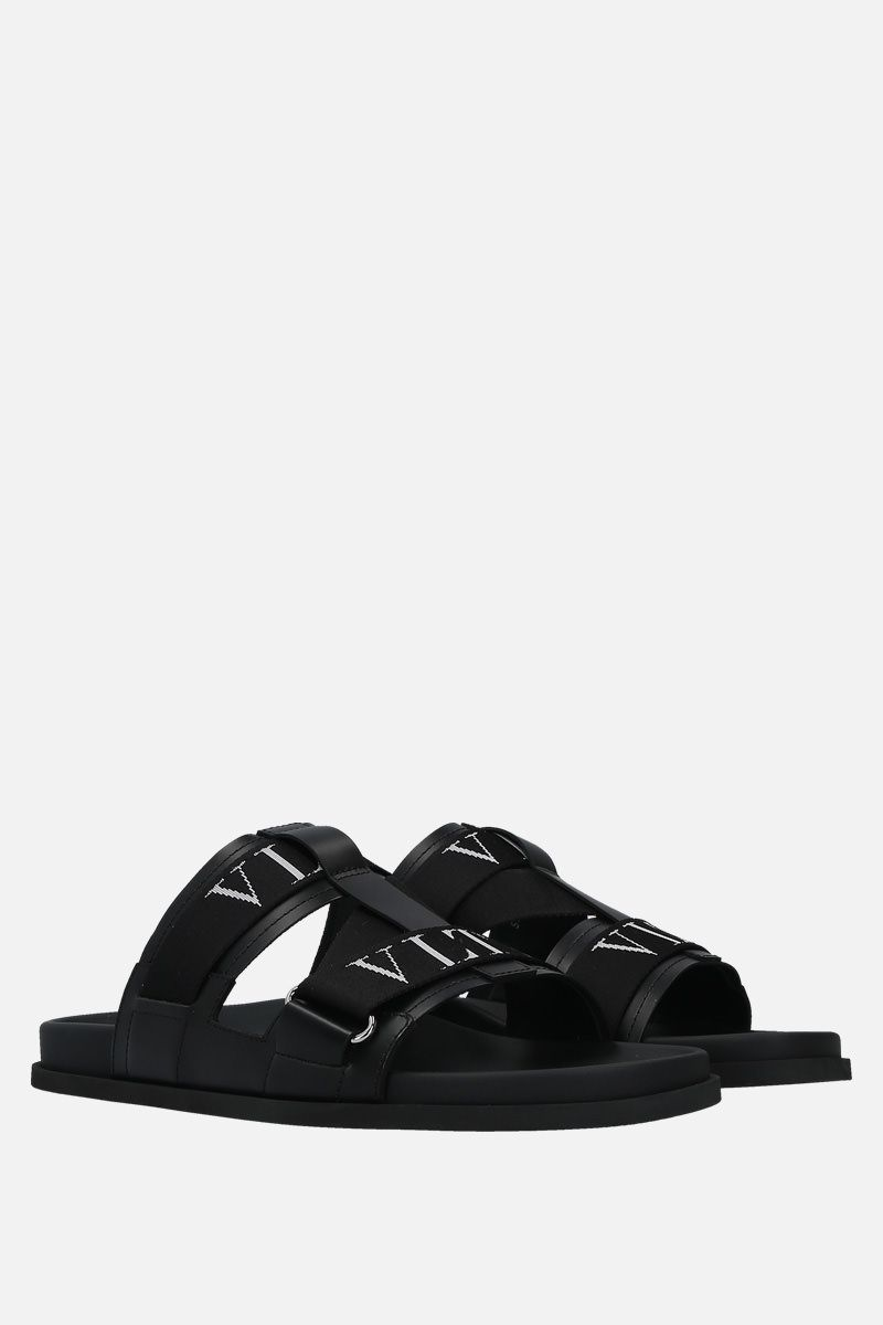 VALENTINO GARAVANI: VLTN smooth leather flat sandals Color Black_2