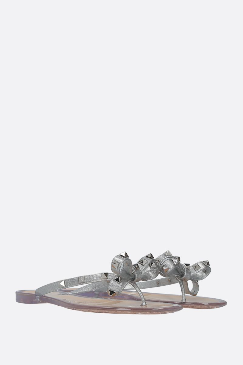 VALENTINO GARAVANI: Rockstud thong sandals in PVC Color Silver_2