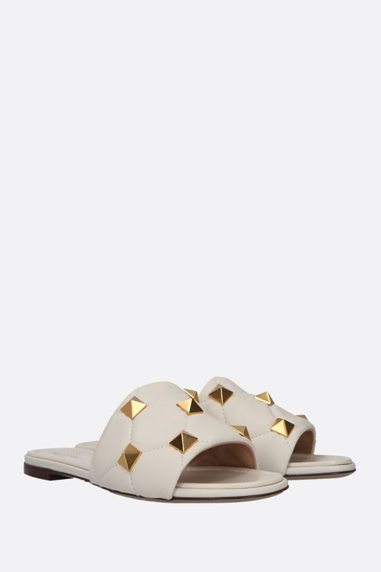 VALENTINO GARAVANI: Roman Stud quilted nappa slide sandals Color Neutral_2